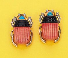 A PAIR OF GEM-SET AND ENAMEL EGYPTIAN REVIVAL SCARAB BROOCHES, BY CARTIER  Each set with a ribbed coral and black enamel body with a turquoise head to the diamond-set eyes and antennae, circa 1938, with French assay marks  Signed by Cartier, Paris, nos. 09051 and 09056