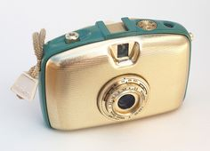 Pentacon Penti  This is the first model of the Penti, made in Germany in 1959. It uses 35mm film in special cassettes. The frame surrounding the gold-colored front and back was available in various enamel colors. A really beautiful camera.