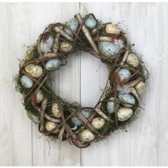Celebrate Easter in style with our plaited wicker wreath. Twisted wicker encases moss and pastel coloured eggs, this wreath will bring a rustic touch to your home. Hang from the front door to welcome guests or simply on in your home to celebrate Easter. You could even use this lying down filled with candles or flowers as a table centerpiece.    Find it at:  http://www.pasttimes.com/gift_finder/by_occasion/easter_gifts/plaited_wicker_moss_wreath-870062.htm