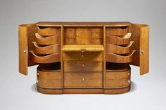 Scene: Harrison had Sean choose an armoire and dresser to go in Shawn's bedroom on the top floor. This is what Shawn chose.  Meuble de rangement, Pierre Chareau, 1922