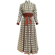 1970s brown and silver maxi lace dress  | From a collection of rare vintage maxi-dresses at https://www.1stdibs.com/fashion/clothing/day-dresses/maxi-dresses/