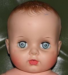 Vintage Uneeda 21 inch Baby Doll, Drink & Wet, Sleep Eyes, Large Spiral Blue Eyes, 60's, 1960. $75.00, via Etsy.