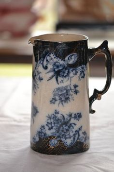 Late 1800s Flow Blue Flanders Pitcher. Of all of my blue and white pins, this has to be my favorite!: