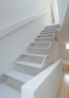 This narrow house contains hollow white boxes for stairs and a skewed upper storey.