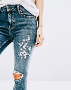 I prefer the subtle flower design on denim. Still like the distressed look