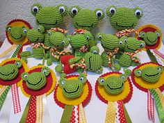 Family of crocheted frogs. No pattern anywhere and this is the only pic but cute!
