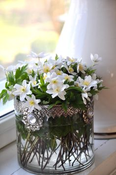 .nice vessel for flowers - must make something similar with round vases from Pier 1