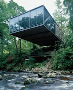 Goulding House by Scott Tallon WalkerDesign for a great gardener, who was so concerned about his beautiful gardens that he wanted the new building to take up as little of the garden as possible, cantilevering over the river.