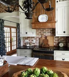 love love love white cabinets, brick and wood accents!!