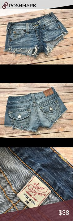 """True religion Joey cut off Jean shorts Sz 24 women's TRUE RELIGON JOEY CUT OFF JEAN SHORTS with zipper fly.    * SIZE is 24  waist measures straight across 14""""  inseam is 1.5 """"  Rise 6.75""""  Hips straight across 16""""   * CONDITION is Gently Used. There is what appears to be a red paint mark on the back pocket- in my opinion it adds character to the distressed look!   * MADE of 100% cotton.   Smoke/pet free home True Religion Shorts Jean Shorts"""