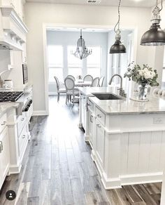 Love the white cabinets and wood floors - white kitchen http://amzn.to/2keVOw4