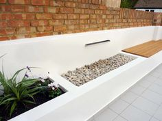 Rendered walls raised beds for house refurbishment