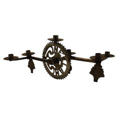Bike sprocket candelabra- surprisingly elegant! #bike parts #candle holder #candelabra #upcycle $44