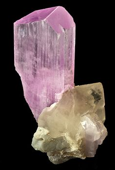 Gorgeous specimen featuring a deep pink Kunzite perched atop a Quartz crystal!