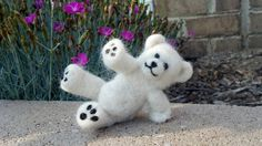 "Needle-felted ""fallen"" teddy bear made of 100% alpaca fiber."
