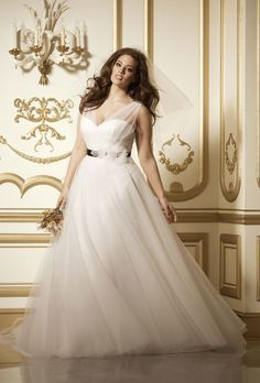 "Brides.com: Designer Plus-Size Wedding Dresses We Love. Style 11713, ""Phoenix"" ivory tulle v-neck, v-back with full skirt, $1,600, Wtoo See more Wtoo wedding dresses."
