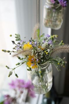 Use recycled jam jars to make these hanging wildflower bouquets.