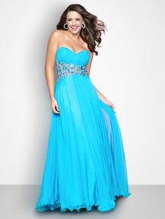 Being full figured does not mean you have to settle for a prom dress! The Blush plus size prom gown 100W is a simple yet stunning floor length evening gown with a strapless sweetheart neckline with rushing that sits on top of a fitted wide empire waist that features crystal and tonal hand beading. This flowing dress would be perfect for showing off your full figure!