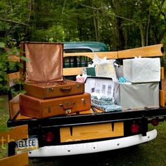 At the start of the paths that led to the ceremony, Jessica and Doug parked an antique pick-up truck where guests could leave thier gifts. Not only a super-cute idea, it made for easy transport back to the house afterward.