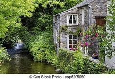 Old English Cottage | Old English cottage on river - csp6205050