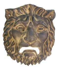 Ancient Roman. Bronze plaque of a fierce lion with full mane, hollow in the back. Holes on the sides. Brown patina. 100-200 AD