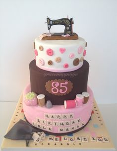 A 3 Tier Cake For A Grandma Who Loves Pink Brown Playing Scrabble And Sewing on Cake Central 80th Birthday Cake For Grandma, Grandma Cake, 80 Birthday Cake, 80th Birthday Invitations, Sewing Machine Cake, Sewing Cake, Cake Machine, 3 Tier Cake, Tiered Cakes