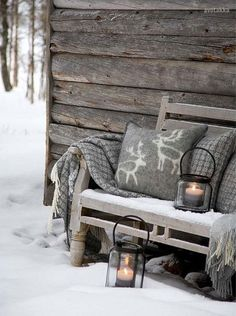 Scandinavian inspired winter home decor. Natural wood with grey and lanters.