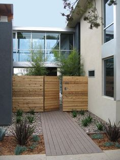entryway, wooden gate, deck path, river rock - same plants planted on grid