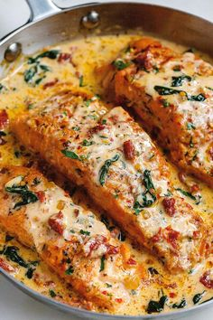 Creamy Garlic Tuscan Salmon – Smothered in a luscious garlic butter spinach and sun-dried tomato cream sauce, you won't believe how easy, fast and simple it is to cook salmon this way! CLICK HERE to get the recipe