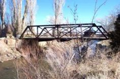 """Old Iron Bridge"" 4 5 Date: Circa 1918 6 7 Location: The bridge is located in Wellington, just off of Smith Gage Road and Hwy. 8 208. It traverses the West Walker River on the James Compston Jr. Ranch. 9 10 History: The iron bridge, a Delaware/Lacawana train bridge, was erected about 1918, 11 to replace a wooden bridge that crossed the West Walker River. All travelers coming 12 into Smith Valley by way of Jack Wright Pass used the Iron Bridge. The original road 13 came through what is…"