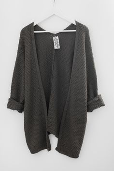 - Slouchy sweater knit cardigan - Long dolman sleeves - Loose fitting - Asymmetrical silhouette - 55% Acrylic 45% Cotton - Imported