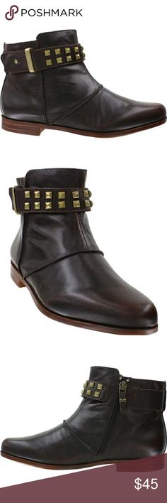 """Earthies """"Treano"""" Studded Black Leather Booties The Earthies Treano is a casual women's low boot with buckle accent.  Earthies shoes are beautifully designed and crafted for women who care about their personal health and longevity. Each Earthies shoe comes with a unique wellness footbed with a cupped heel, anatomic arch support, and cradled toe area for the ultimate fit.  Crafted in premium leather Glove-soft leather lining Side zip Exclusive contoured comfort design supports your foot from…"""