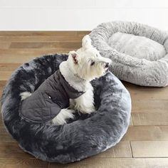 Featuring the same irresistible softness and indulgent warmth of our Luxury Faux Fur Collection, this sumptuous pet bed will chase away your pet's winter    chill. Densely woven using innovative fibers that replicate real fur, our faux fur boasts a supple hand and distinctive shading.            85% acrylic and 15% polyester                Densely woven to 700 gsm                Generously stuffed cushion and bolster provide dream-inducing comfort and support                Removable faux...