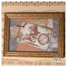 An old frame, some papers, stamping, embossing and distress inks!!