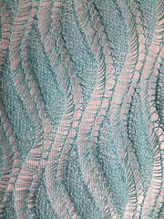 Undulating waves of dropped stitches in luscious hand painted Aran weight yarn.