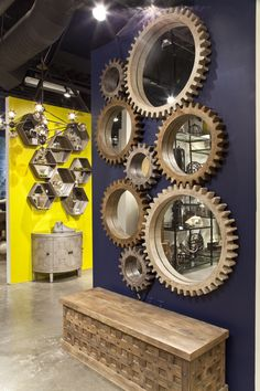 Our popular Cog Mirrors displayed in a large wall collection in our showroom.  Sold separately, create the desired look for any size wall.  Small (37142), Medium (37141), Large (37140)
