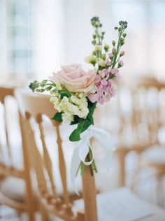 Image by Peachey Photography - A Lambina dress by Pronovias for a Spring wedding at Northbrook park in Surrey with a pink rose bouquet by Peachey Photography.