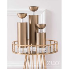 A10320- Cylinder Candle Holder Lg Gold- Put your candle on a pedestal. This mod candle holder with its simple cylinder base and sleek round top is a must have. Place a pair on your dining table, buffet table or mantle for a lovely display. Mix them with the other sizes for impact. Velvet Furniture, Accent Furniture, Lantern Candle Holders, Candle Lanterns, Cozy Sofa, Round Top, Pedestal, Mantle, Buffet