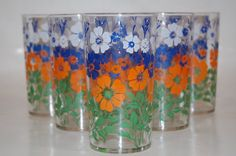 """Set of 6 six vintage TUMBLERS with a burst of orange blue green and white FLOWERS pansies 4.75"""" Tall"""