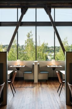 Graham Baba Architects transformed former sawmill into open-plan industrial restaurant Seattle Restaurants, Seattle Food, Stool Makeover, Garage Door Styles, Booth Seating, Industrial Restaurant, Exposed Wood, Wood Ceilings, Architect Design