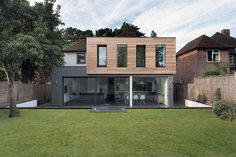 Nice mix of timber cladding and a rendered extension on a traditional brick finish house.: