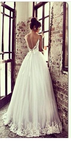 [I love the outline and the gathering of the skirt.  Notice that there's not really a train, but it still looks properly fancy because of the gathering and the lace hem.] Wedding dress