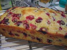 Cranberry-Orange Walnut Bread  Makes 2 large loaves or 6 small loaves or 18 muffins  4 cups all-purpose unbleached flour  2 cups sugar  3 teaspoons baking powder  2 teaspoons salt  1 teaspoon baking soda  1 1/2 cup orange juice  4 tablespoons butter or shortening  2 tablespoons grated orange peel  2 eggs, beaten  3 cups (1 12 ounce package) fresh cranberries  1 cup chopped walnuts or pecans