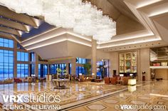 The luxurious lobby at the #Hilton Hangzhou Qiandao Lake Resort in Zhejiang, China overlooks breathtaking views of grand mountains and Qiandao Lake. View more stunning photography here: http://www.vrxstudios.com