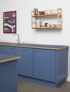 Stilleben Kitchen offers different options for countertops. For longevity, the designers like Silestone, but their favorite is linoleum. Here the countertops are solid oak with a thin layer of dark blue linoleum.