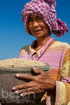 Khmer woman with rice basket