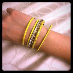 Yellow and Gold Bangles 6 yellow and gold bangles. Sold as a set Jewelry Bracelets