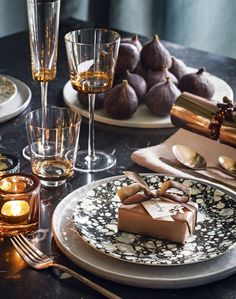 Dark and dramatic Christmas table setting with copper accents