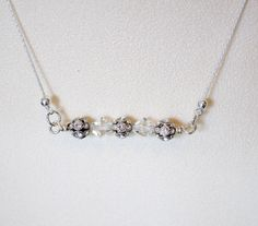 A personal favorite from my Etsy shop https://www.etsy.com/listing/271477603/vintage-inspired-pendant-bar-necklace