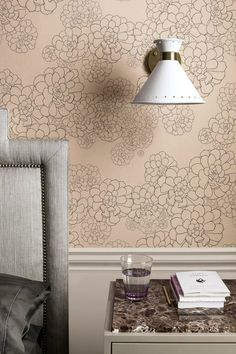 A beautiful wallpaper featuring bold line drawings of aeonium flowers in an all-over pattern. Shown here in the Temple colourway with the flower outlines drawn in grey on a shade of pink.